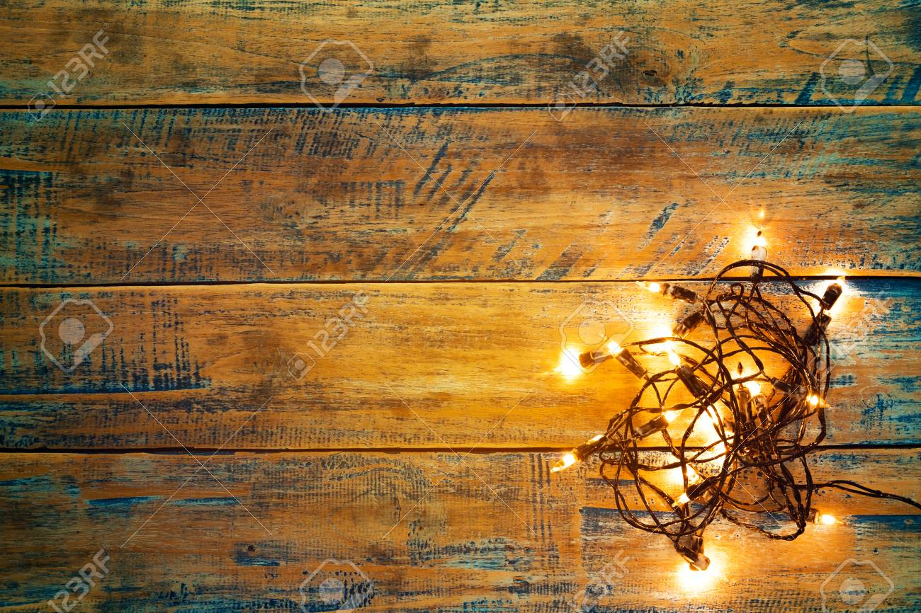 Christmas Lights Bulb On Wood Table Merry Xmas Background