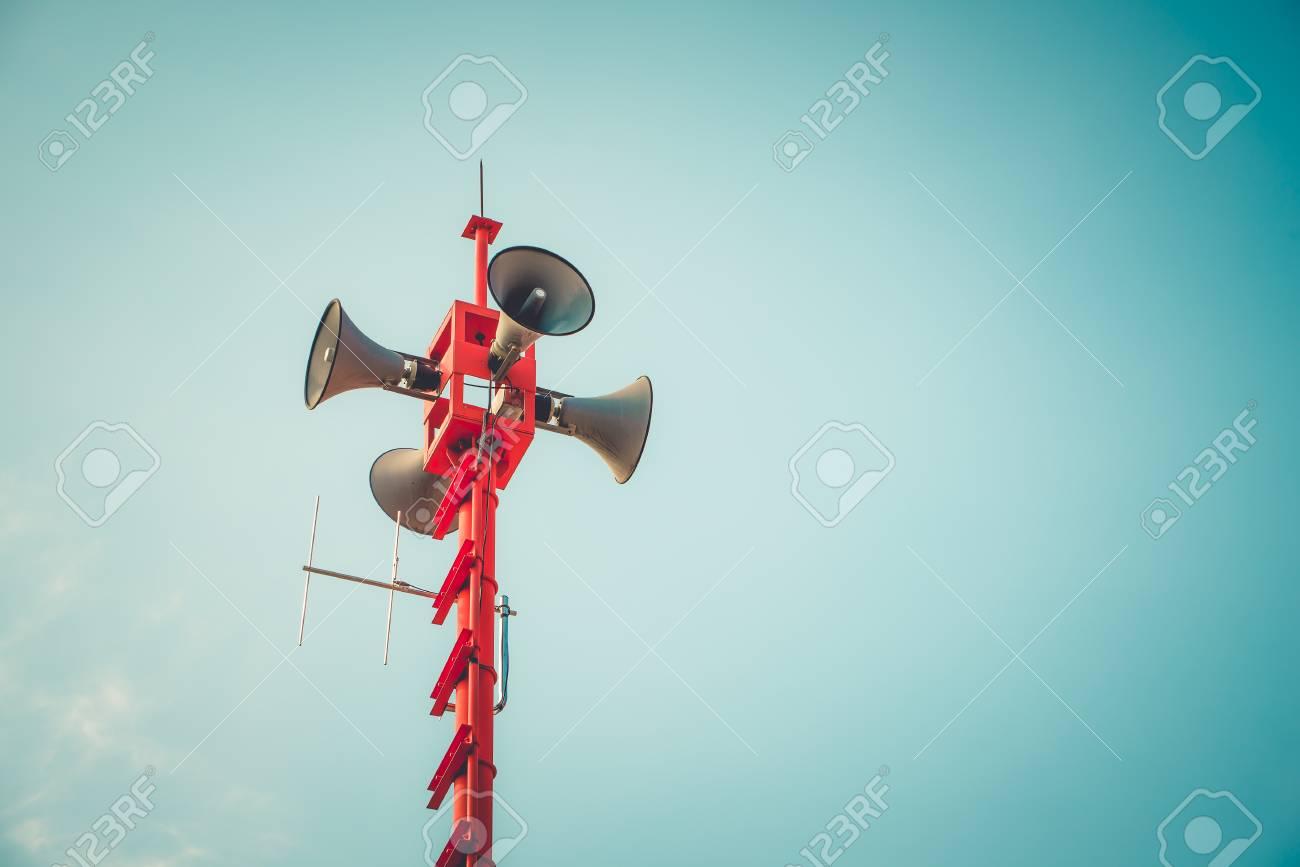 vintage horn speaker - public relations sign and symbol. vintage color tone effect - 121121998
