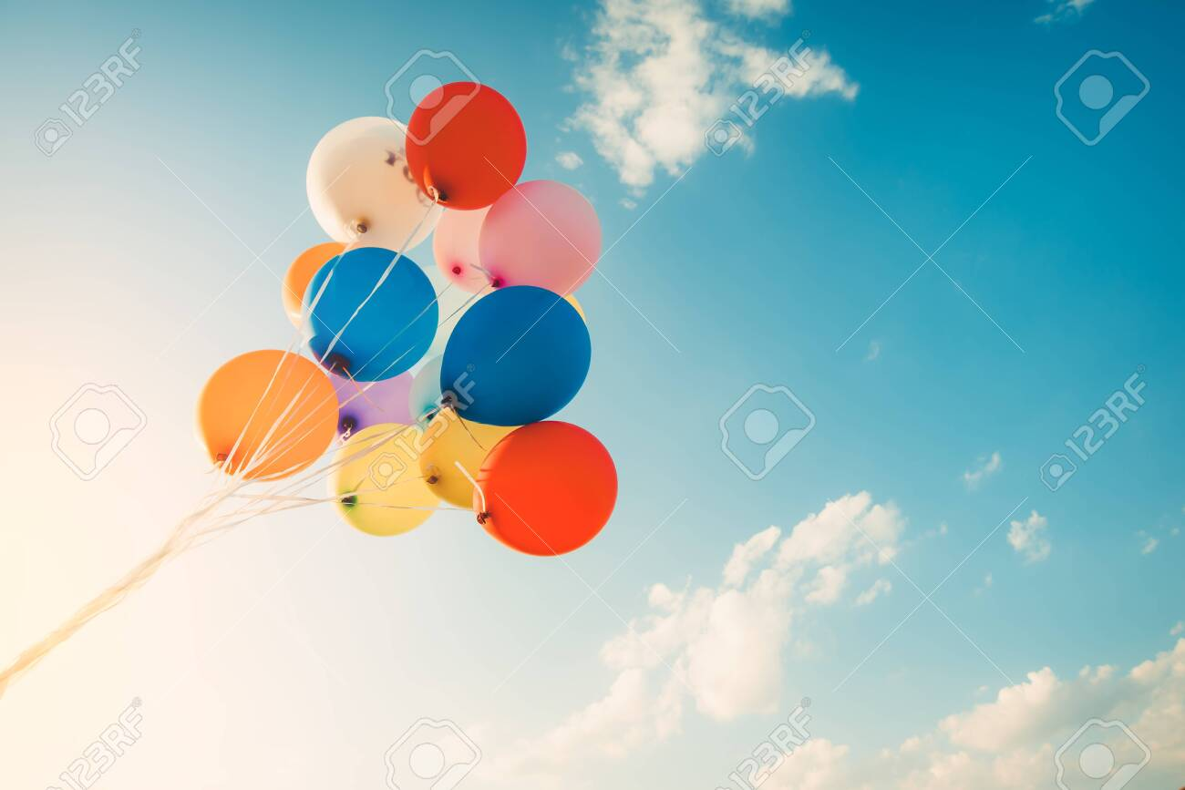 Colorful balloons done with a retro filter effect. Concept of happy birth day in summer and wedding, honeymoon party use for background. Vintage color tone style - 122976569