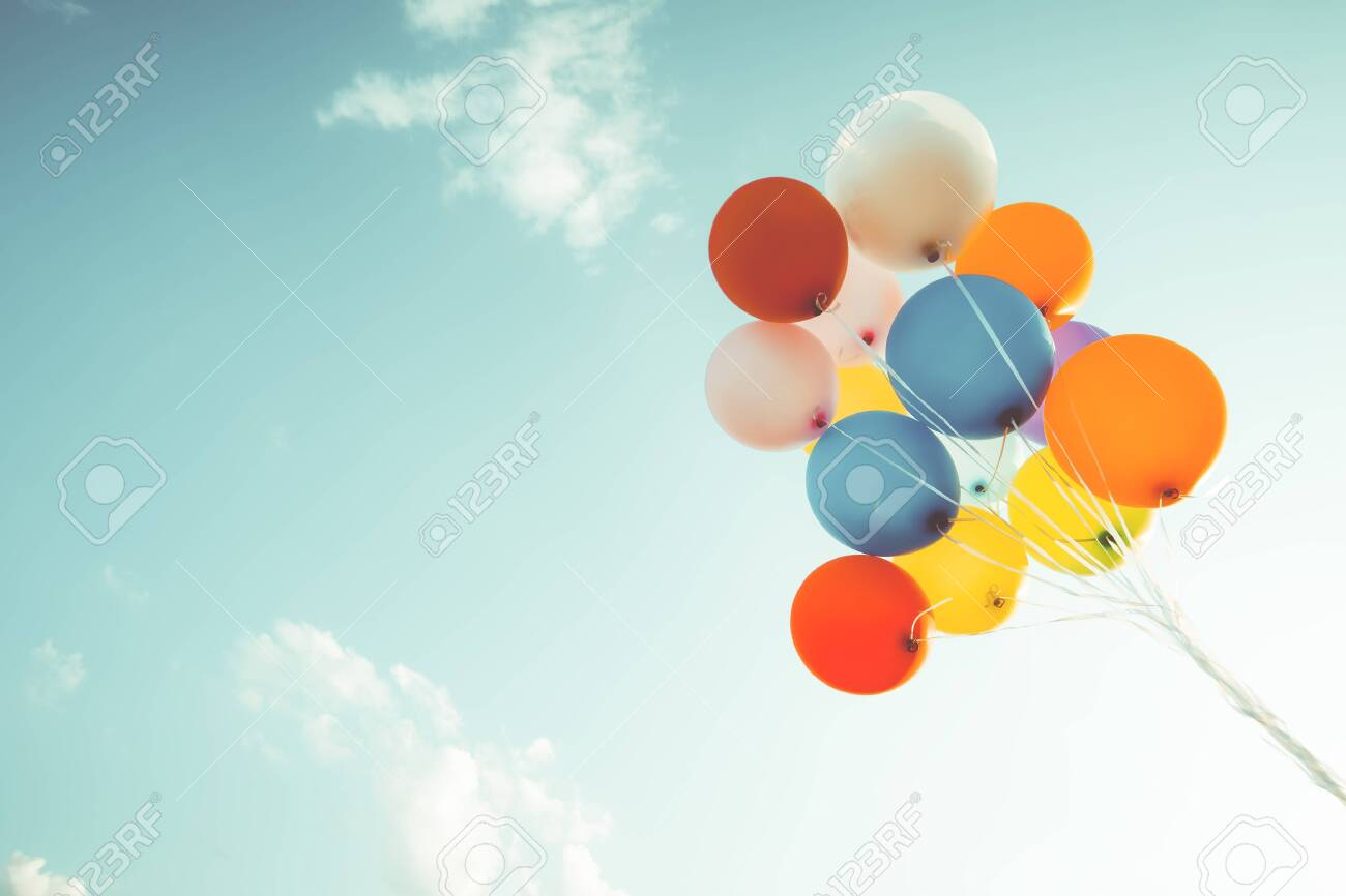 Colorful balloons done with a retro filter effect. Concept of happy birth day in summer and wedding, honeymoon party use for background. Vintage color tone style - 124536055