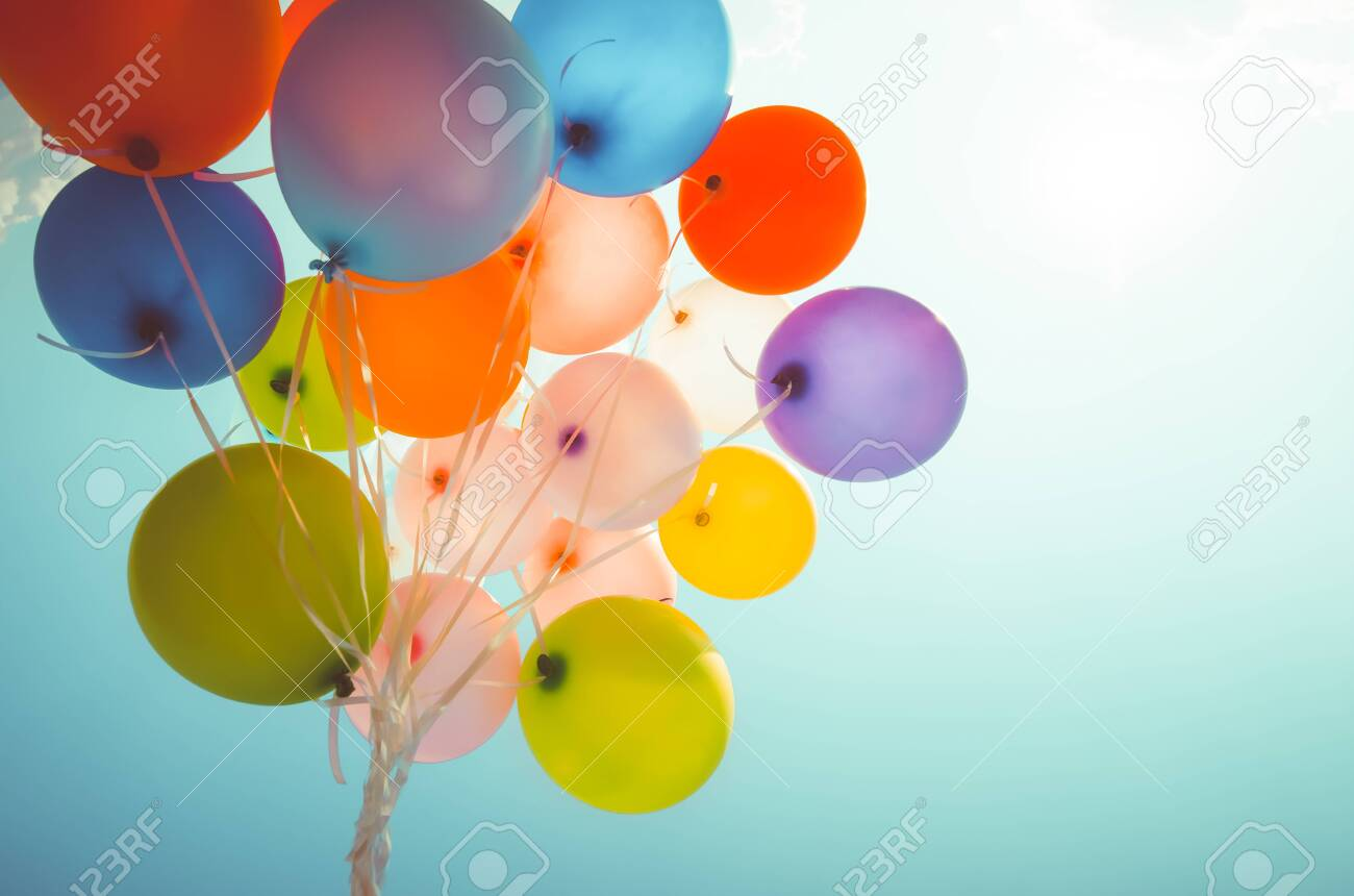 Colorful balloons done with a retro photo filter effect. Concept of happy birth day in summer and wedding, honeymoon party use for background. Vintage color tone style - 125471381