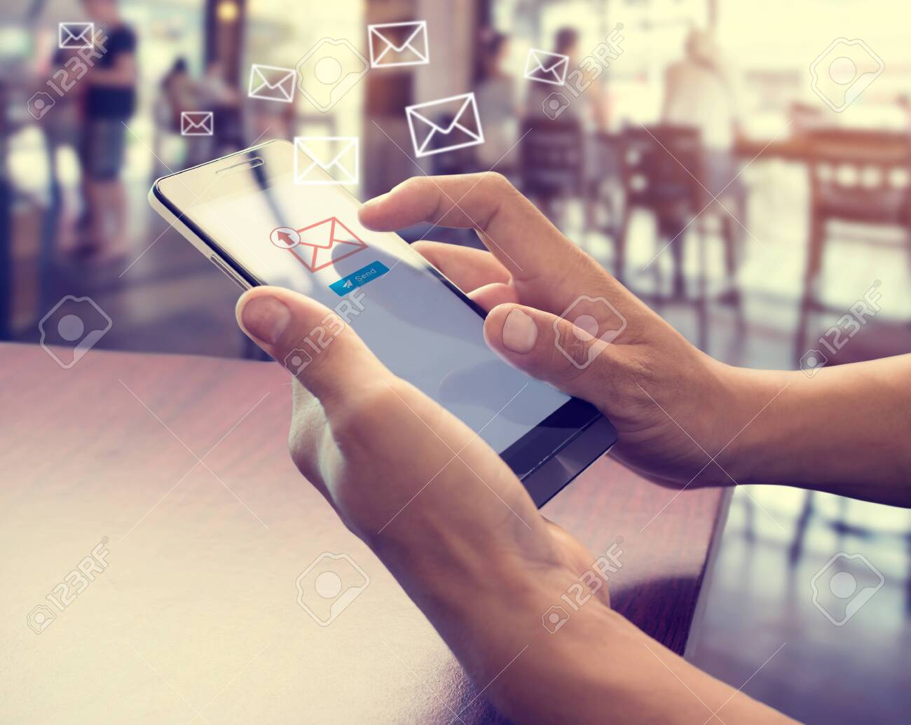 Hand of male using mobile phone to sending E-mail message with email symbol and envelope icon. Email marketing concept - 127898743