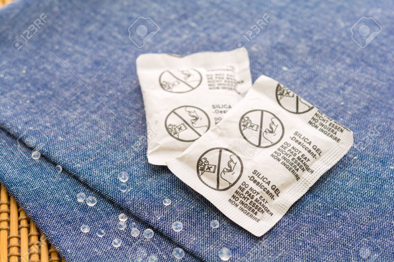 Desiccant Or Silica Gel In Paper Sachet On Blue Fabric Background Gell Stock Photo 71878642