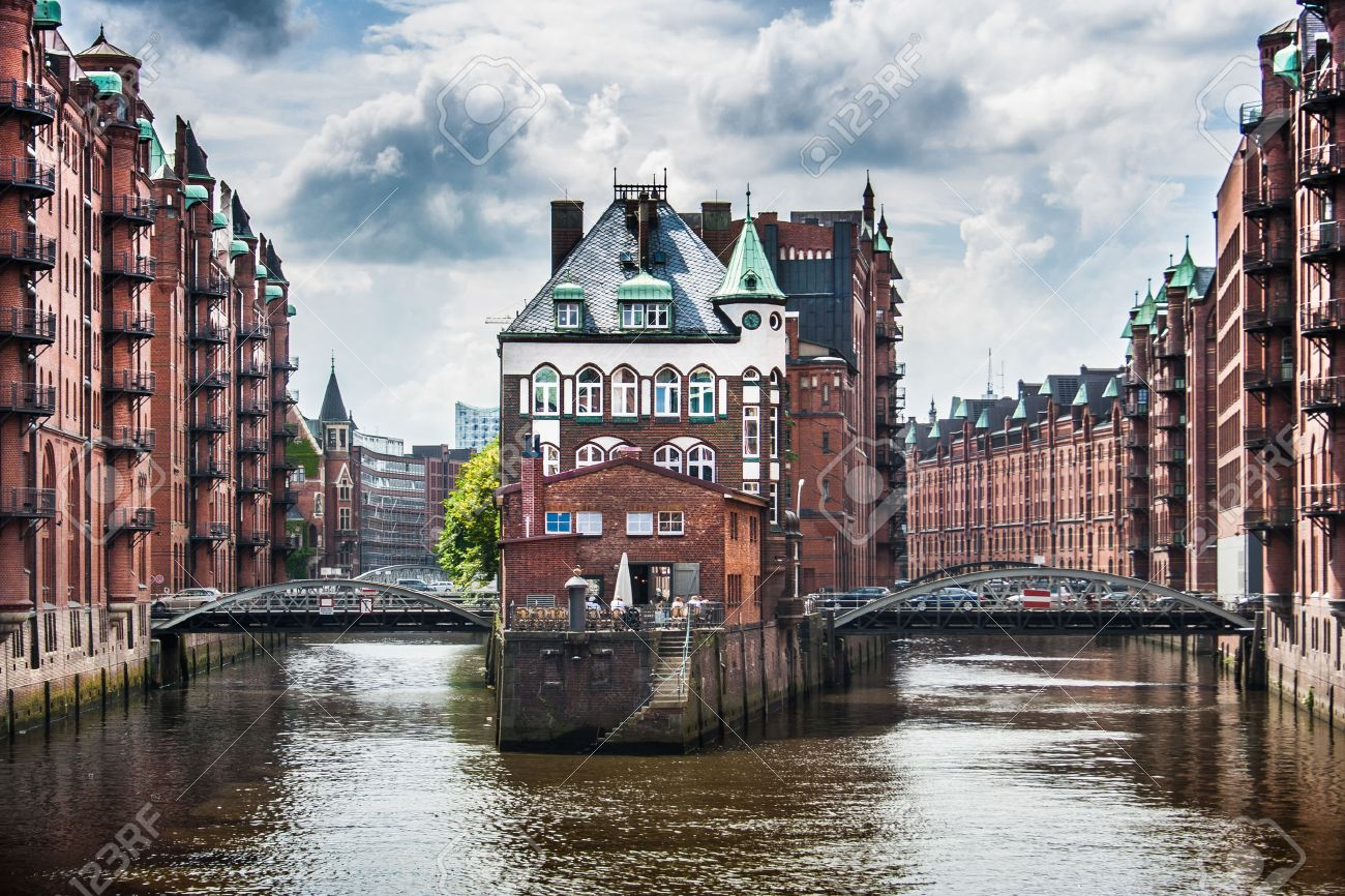 Stock photo hamburg germany riverside new - Hamburg City Famous Speicherstadt Warehouse District With Dark Clouds Before The Storm In Hamburg