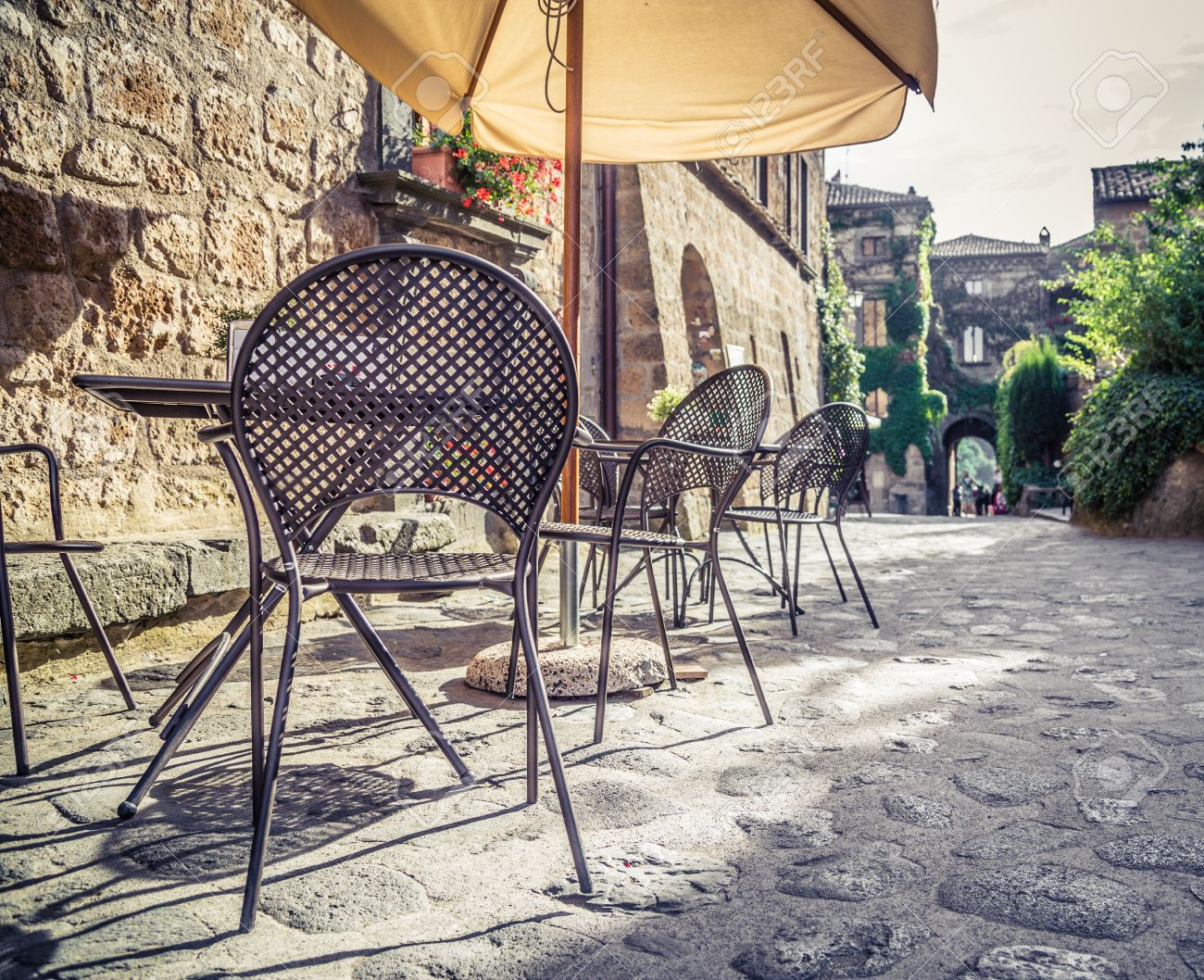 Vintage cafe table and chairs - Cafe With Tables And Chairs In An Old Street In Europe With Retro Vintage Instagram Style