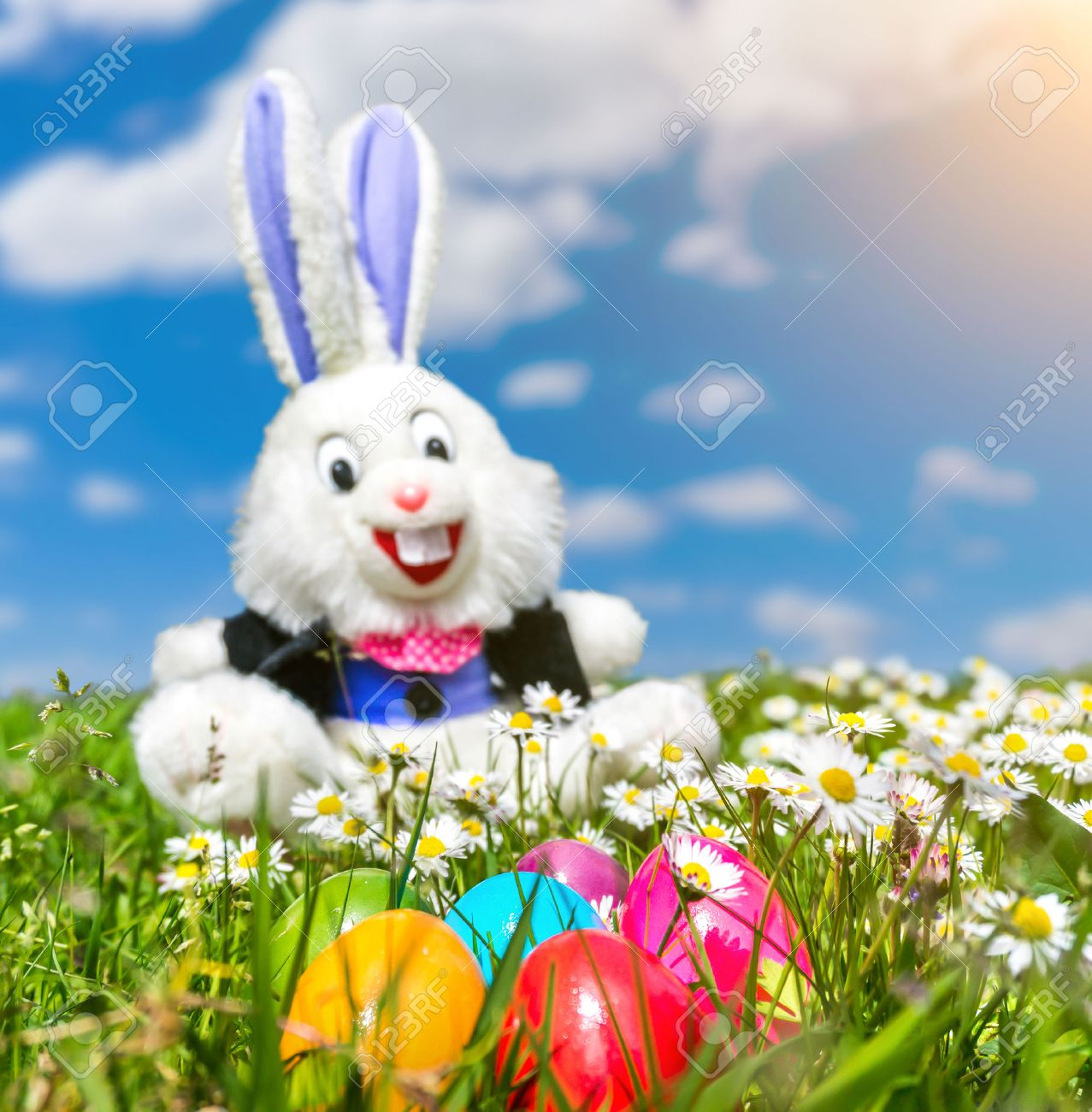 beautiful view of colorful easter eggs with funny easter bunny