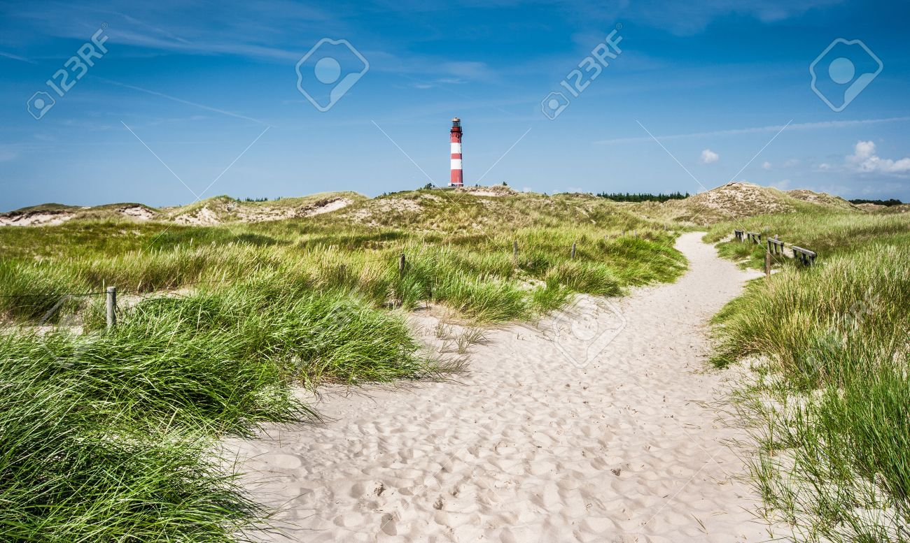 Beautiful dune landscape with traditional lighthouse on the island of Amrum at North Sea, Schleswig-Holstein, Germany - 44062583