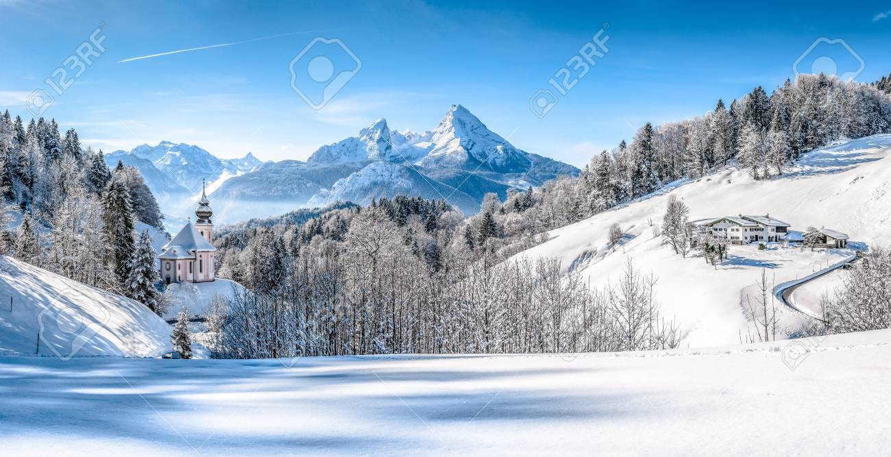 Panoramic view of beautiful winter landscape in the Bavarian Alps with pilgrimage church of Maria Gern and famous Watzmann massif in the background, Nationalpark Berchtesgadener Land, Bavaria, Germany - 49066516