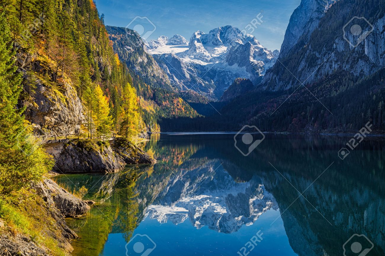 Mountain range stock photos pictures royalty free mountain beautiful view of idyllic colorful autumn scenery with dachstein mountain summit reflecting in crystal clear gosausee sciox Gallery