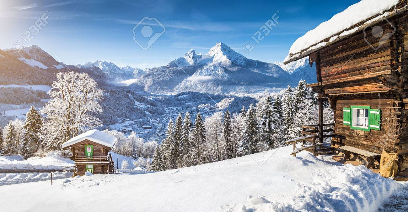 Panoramic view of beautiful winter wonderland mountain scenery in the Alps with traditional mountain chalets - 55032446