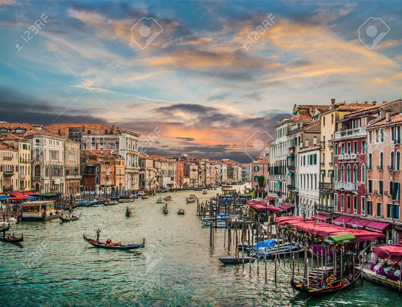 Panoramic view of famous Canal Grande from famous Rialto Bridge at sunset in Venice, Italy with retro vintage Instagram style filter effect Stock Photo - 75527271