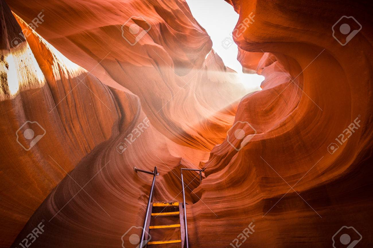 Beautiful view of amazing sandstone formations with a ladder leading toward a magic light beam in famous Antelope Canyon near the historic town of Page at Lake Powell, American Southwest, Arizona, USA - 80060411