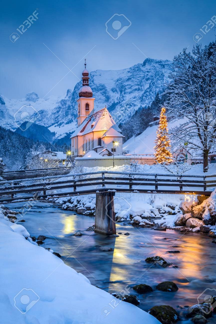 Beautiful twilight view of Sankt Sebastian pilgrimage church with decorated Christmas tree illuminated during blue hour at dusk in winter, Ramsau, Nationalpark Berchtesgadener Land, Bavaria, Germany - 96566761