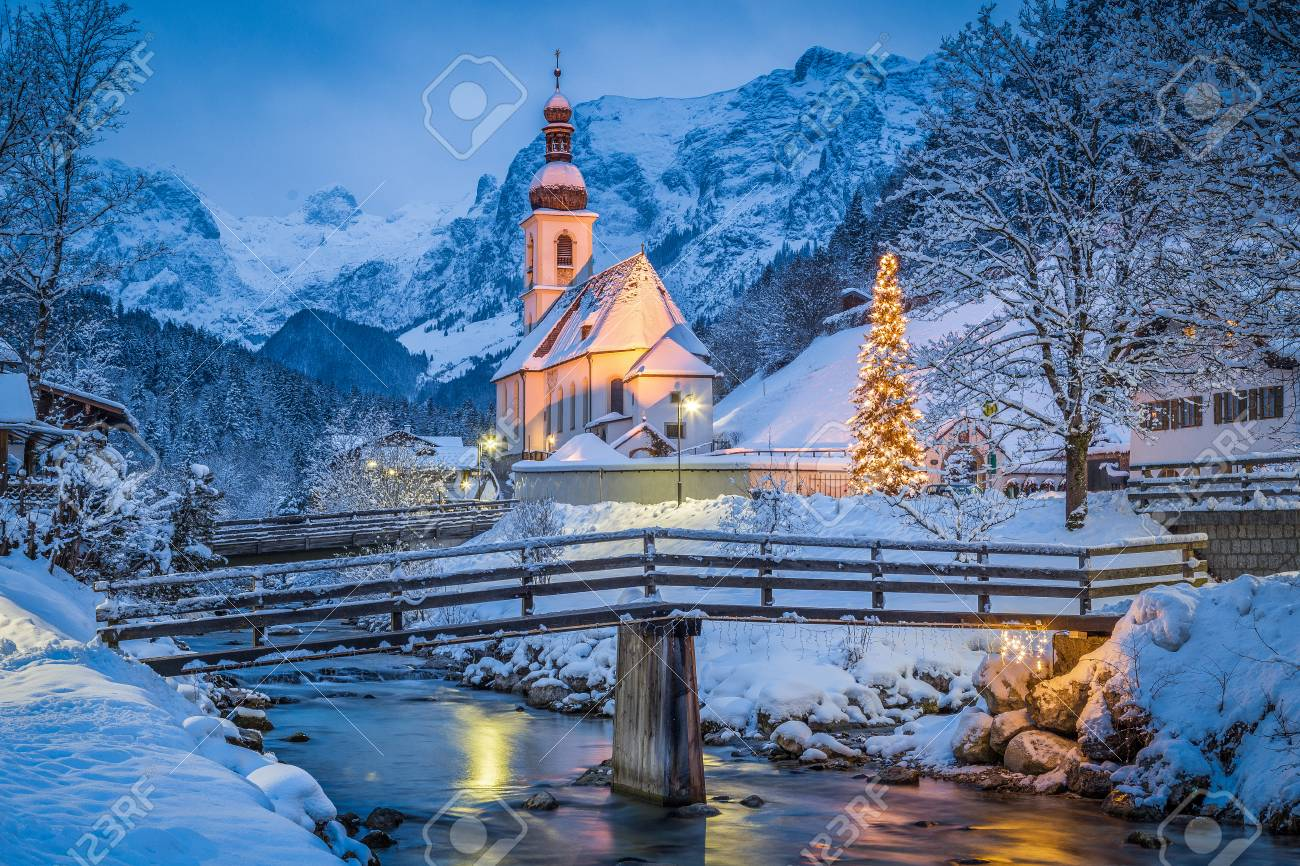Beautiful twilight view of Sankt Sebastian pilgrimage church with decorated Christmas tree illuminated during blue hour at dusk in winter, Ramsau, Nationalpark Berchtesgadener Land, Bavaria, Germany - 96513997