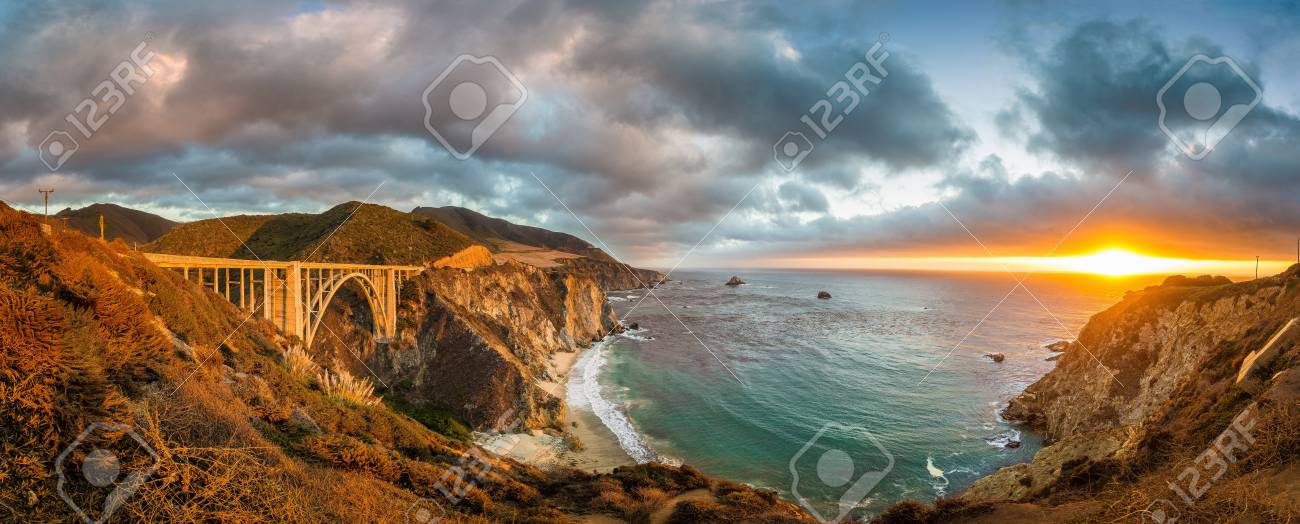 Scenic panoramic view of historic Bixby Creek Bridge along world famous Highway 1 in beautiful golden evening light at sunset with dramatic cloudscape in summer, Monterey County, California, USA - 98272249