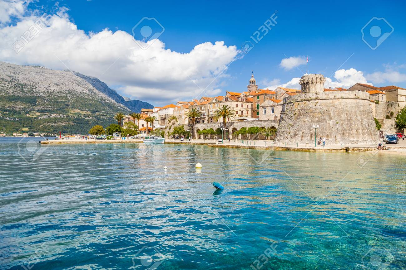 Beautiful view of the historic town of Korcula on a beautiful sunny day with blue sky and clouds in summer, Island of Korcula, Dalmatia, Croatia - 100156315