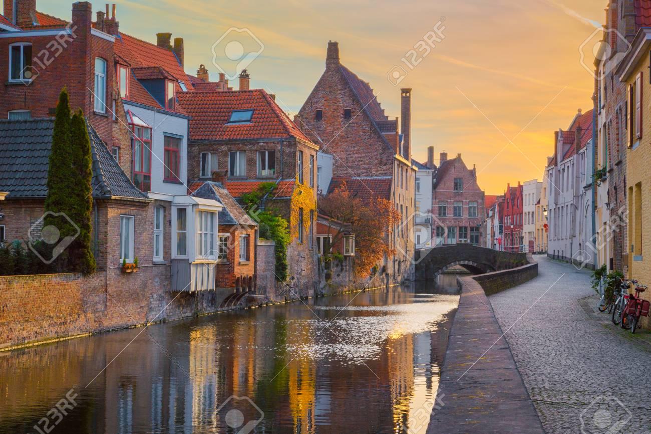 Historic city of Brugge at sunrise, Flanders, Belgium - 100199020