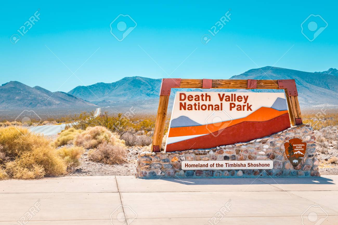 Classic view of famous Death Valley National Park entrance sign on a sunny day with blue sky in summer, California, USA - 113995741