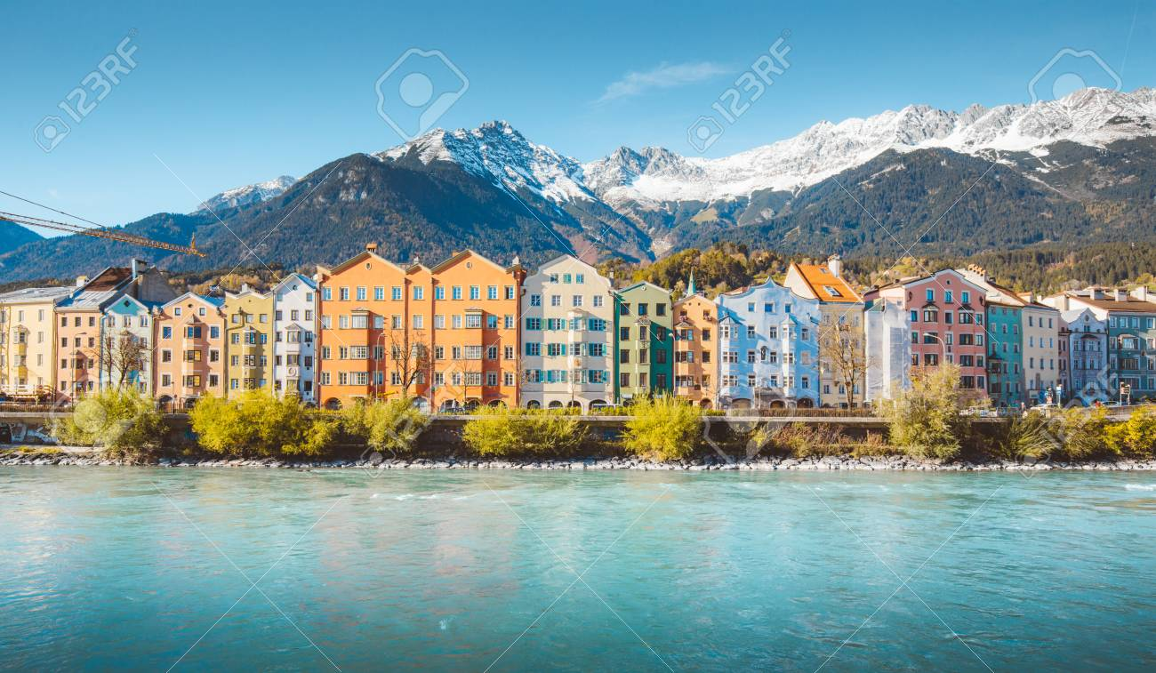 Panoramic view of the historic city center of Innsbruck with colorful houses along Inn river and famous Austrian - 113997488