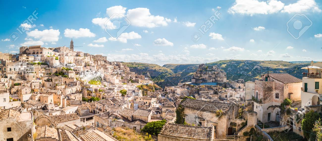 Panoramic view of the ancient town of Matera (Sassi di Matera) on a sunny day - 113996877