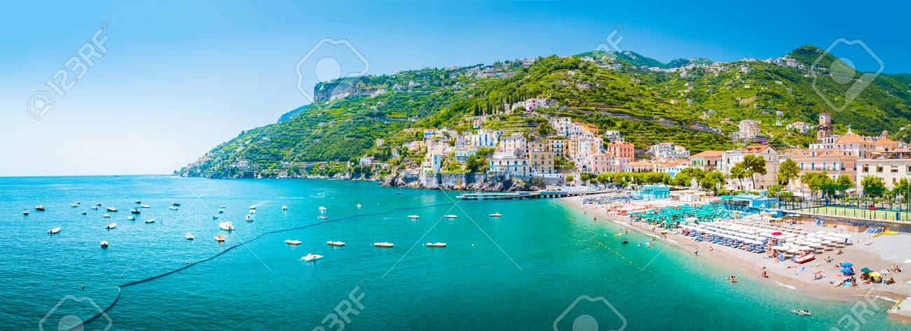 Scenic panoramic view of the beautiful town of Amalfi at famous Amalfi Coast with Gulf of Salerno in summer, Campania, Italy - 113996049