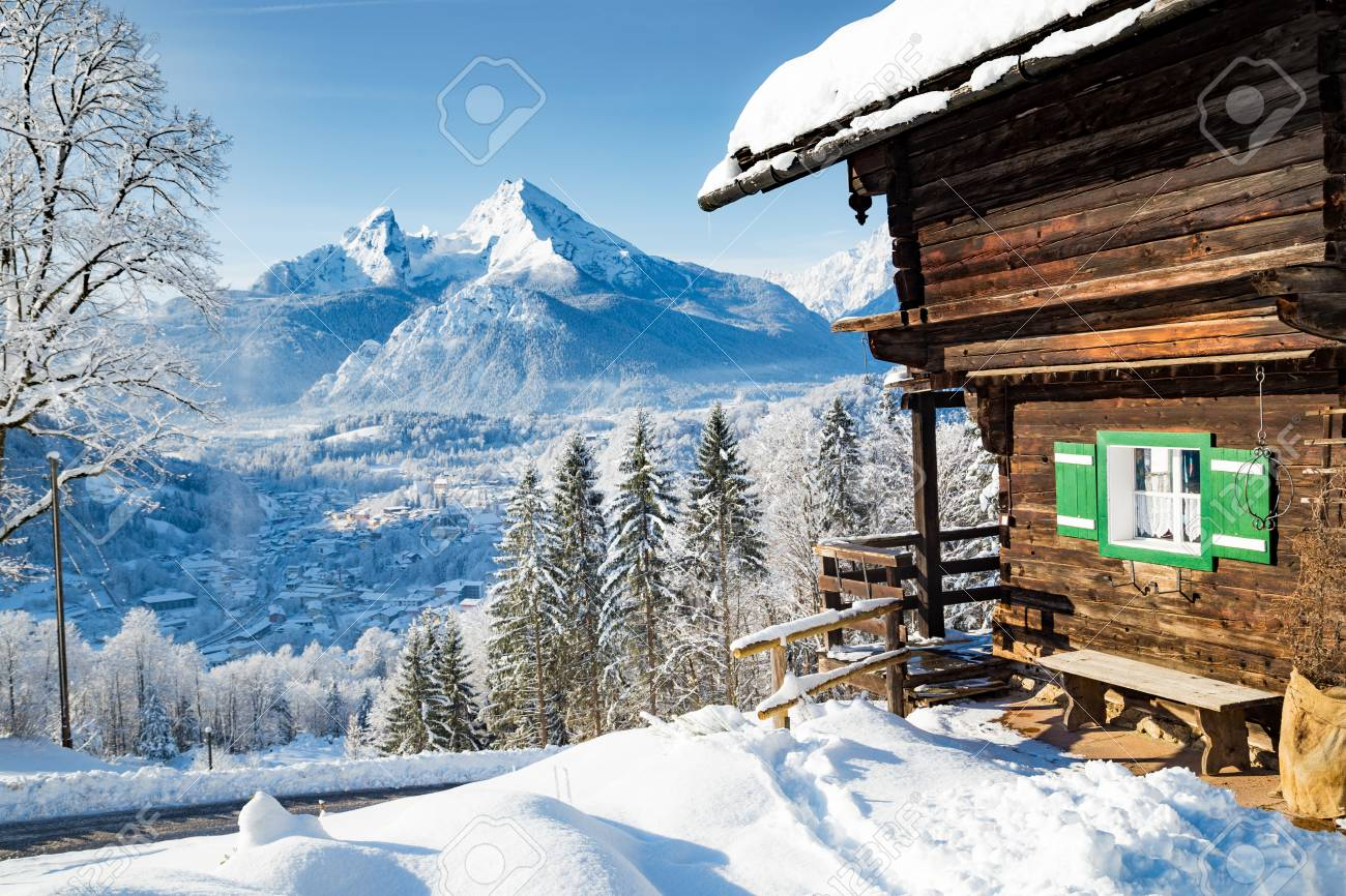 Beautiful view of traditional wooden mountain cabin in scenic winter wonderland mountain scenery in the Alps - 119002927