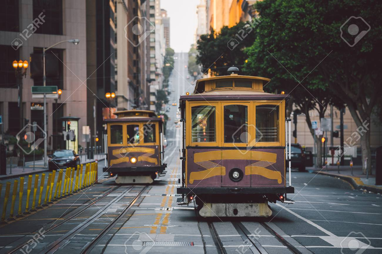 Classic panorama view of historic San Francisco Cable Cars on famous California Street at sunset with retro vintage style filter effect, central San Francisco, California, USA - 119003321