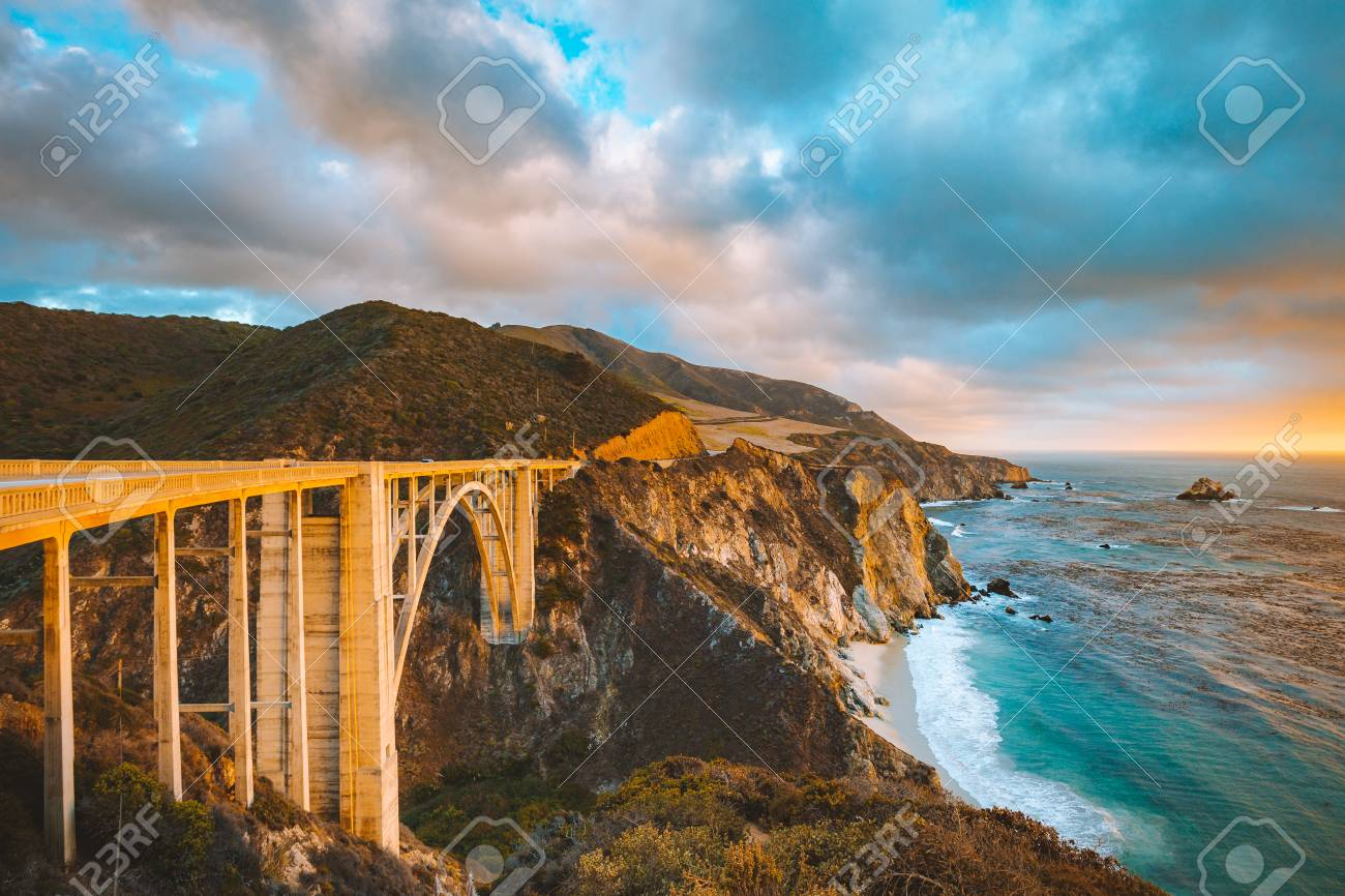 Scenic panoramic view of historic Bixby Creek Bridge along world famous Highway 1 in beautiful golden evening light at sunset with dramatic cloudscape in summer, Monterey County, California, USA - 119086254