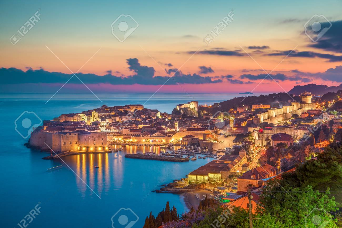 Panoramic aerial view of the historic town of Dubrovnik, one of the most famous tourist destinations in the Mediterranean Sea, in beautiful golden evening light at sunset, Dalmatia, Croatia - 121793433