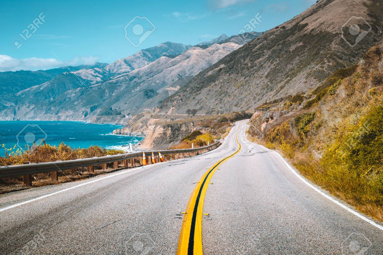 Scenic view of world famous Highway 1 with the rugged coastline of Big Sur in beautiful golden evening light at sunset in summer, California Central Coast, USA - 121794482