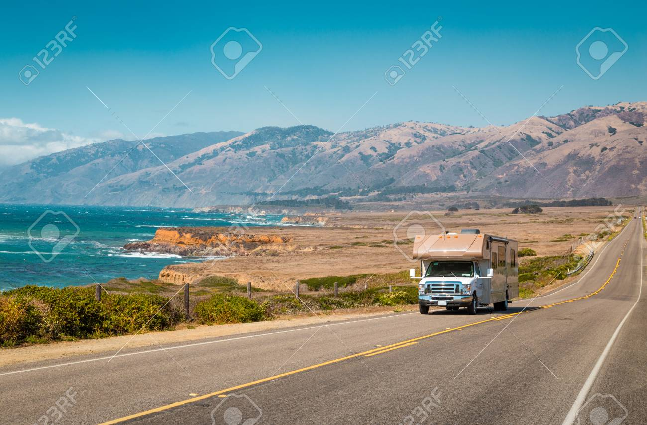 Panorama view of recreational vehicle driving on famous Highway 1 along the beautiful Central Coast of California, Big Sur, USA - 121795155