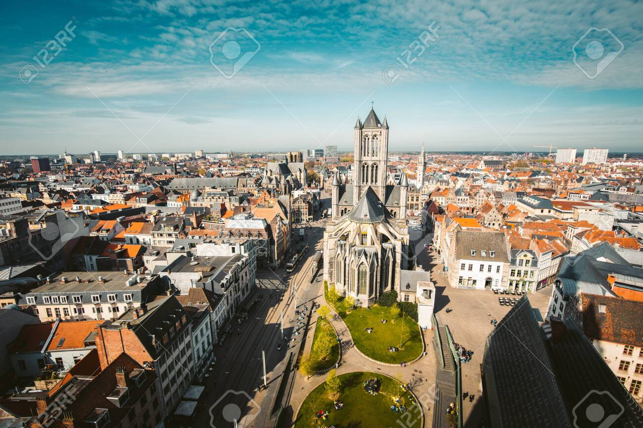 Aerial panoramic view of the historic city of Ghent on a beautiful sunny day with blue sky and clouds in summer, province of East Flanders, Belgium - 121795158