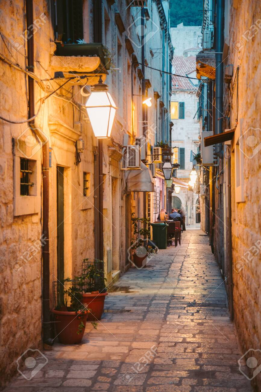 Beautiful twilight view of the historic town of Dubrovnik with narrow alley at dawn, Dalmatia, Croatia - 121795847