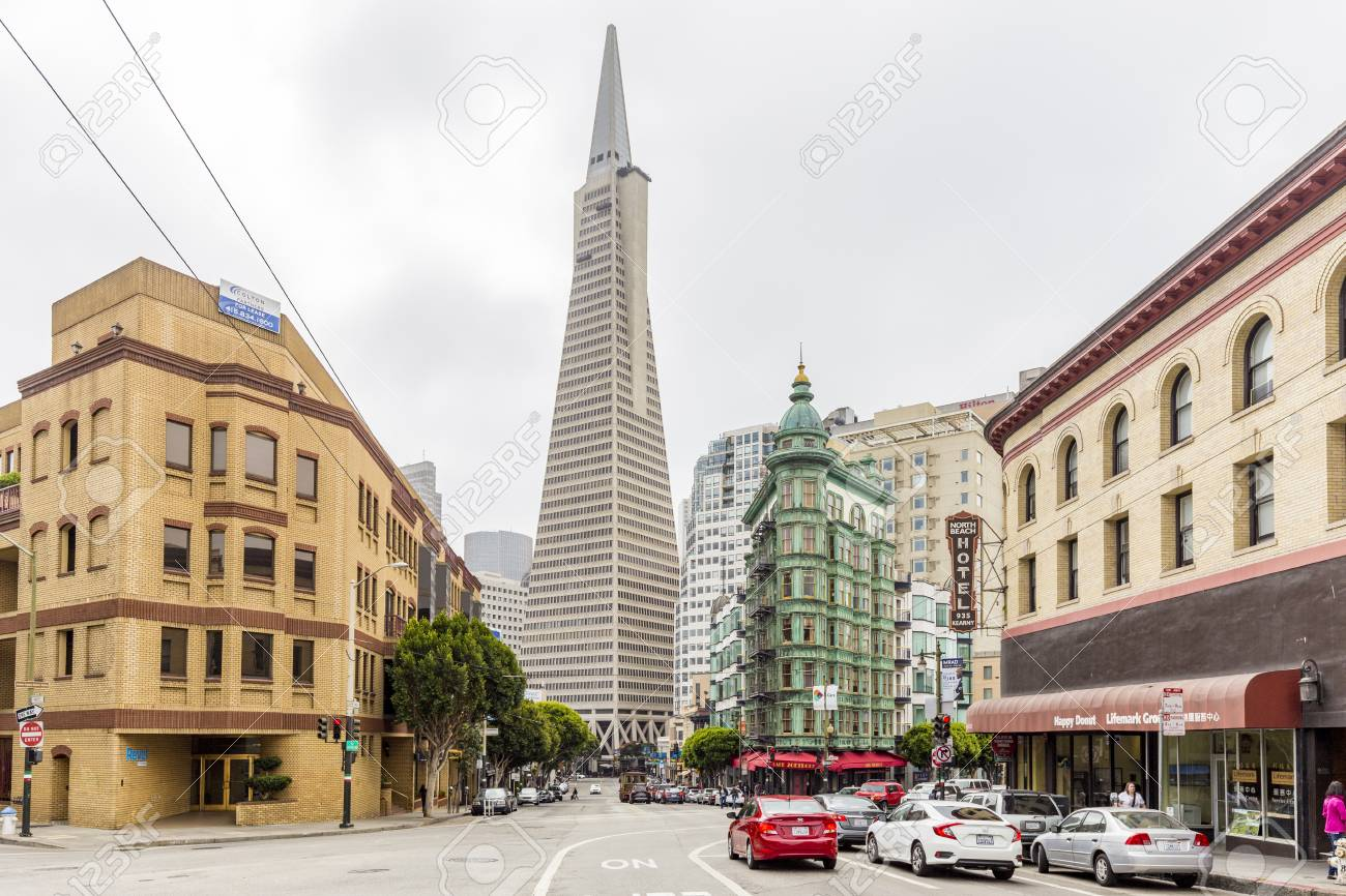 Central San Francisco with famous Transamerica Pyramid and historic Sentinel Building at Columbus Avenue on a cloudy day, California, USA - 121796166