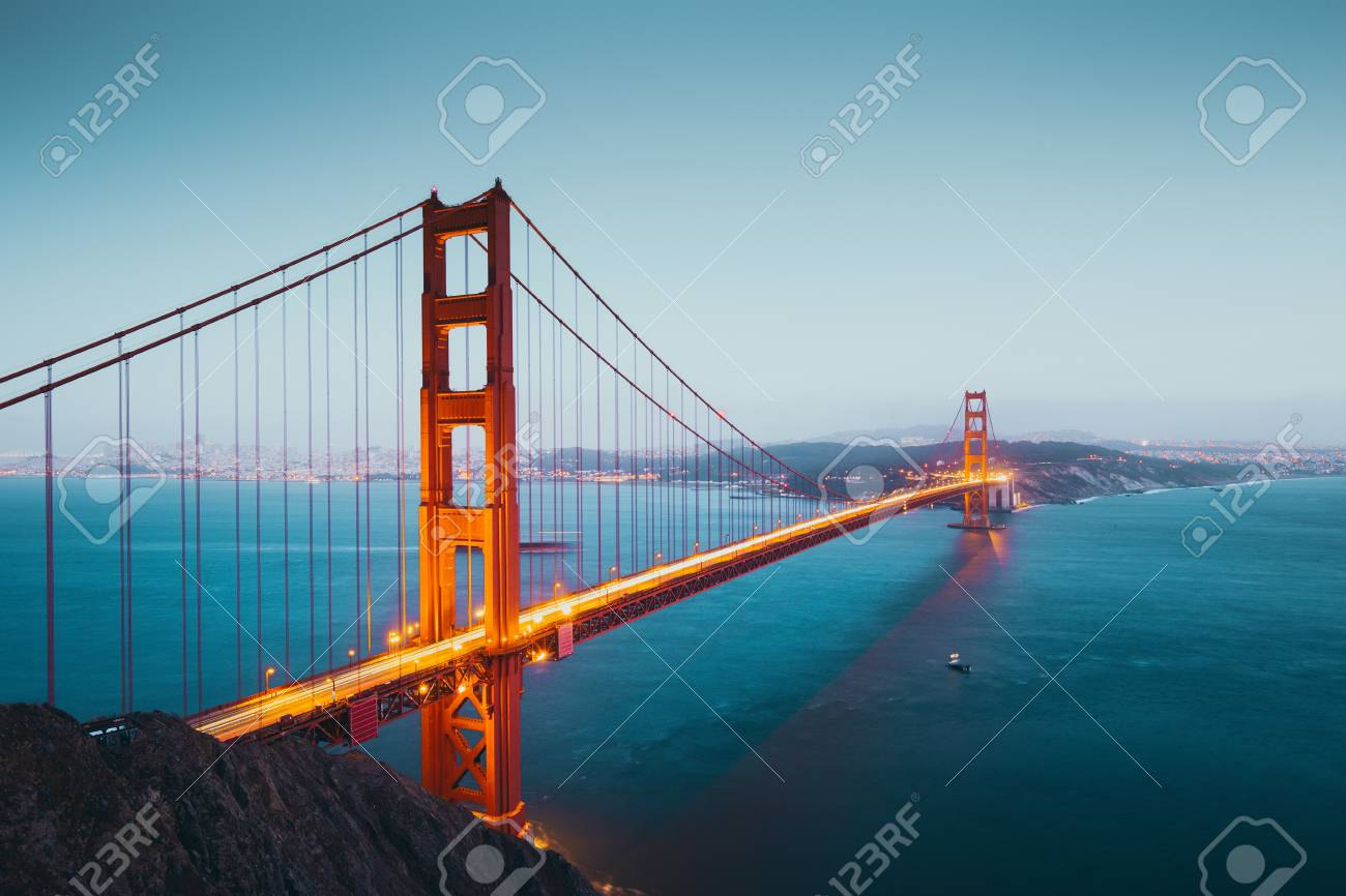 Panoramic view of famous Golden Gate Bridge seen from Battery Spencer viewpoint in beautiful post sunset twilight during blue hour at dusk, San Francisco, USA - 121796205