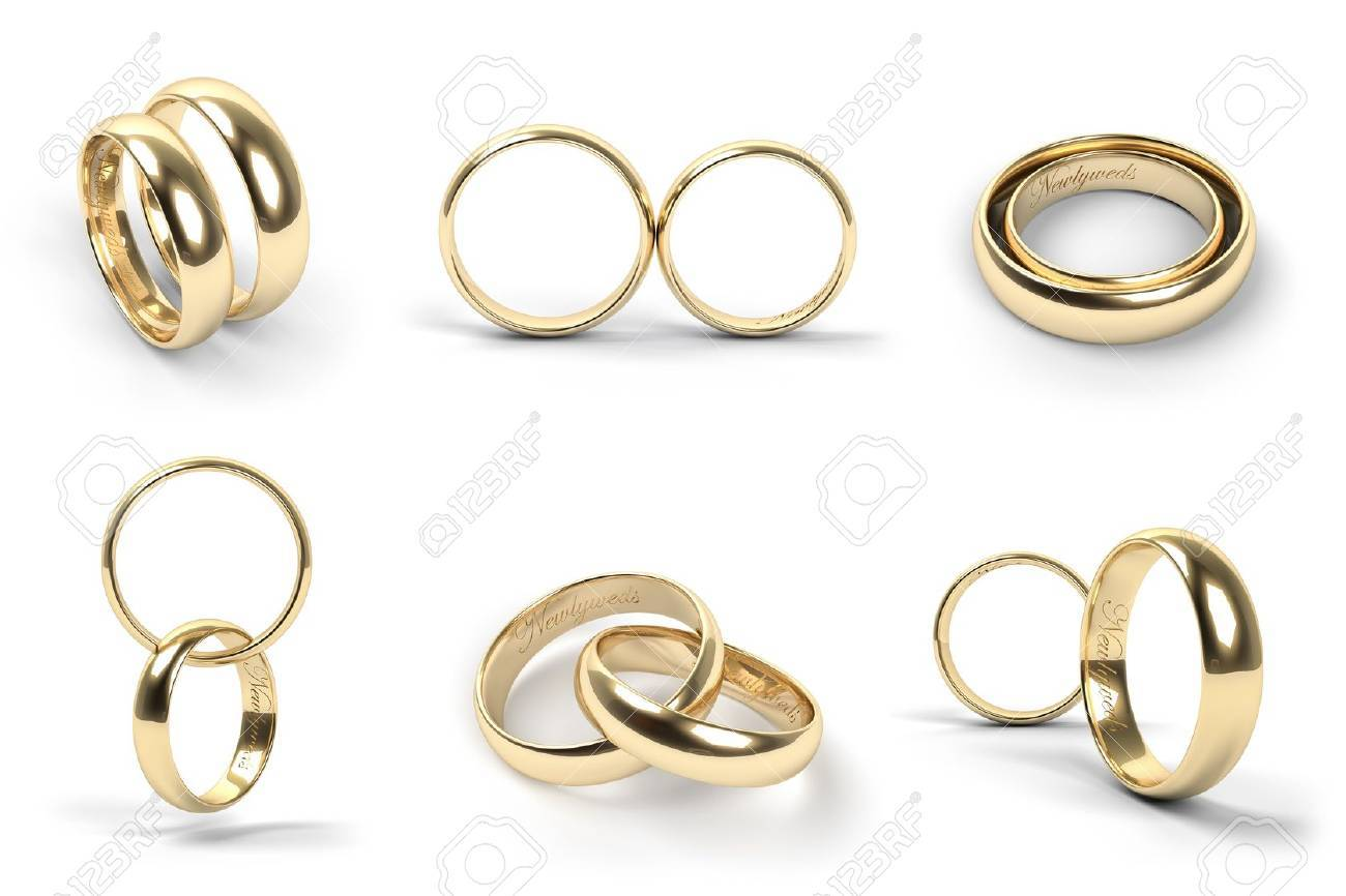 Set Of Gold Wedding Rings Engraved With The Text Newlyweds Stock