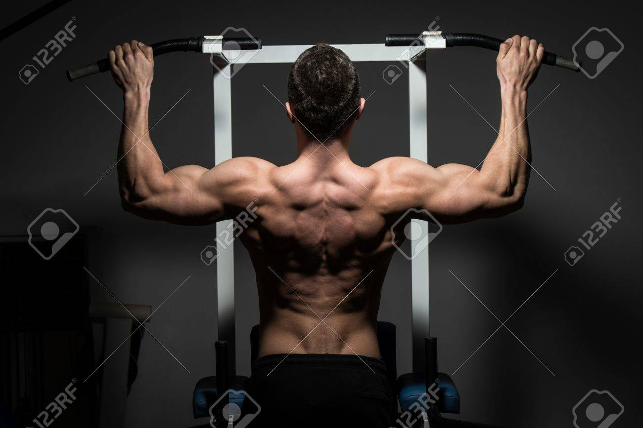young male bodybuilder doing heavy weight exercise Stock Photo - 19593170