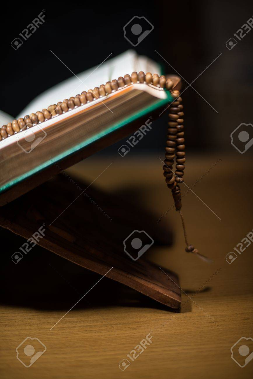 pages of holy koran and rosary at the book Stock Photo - 20251122