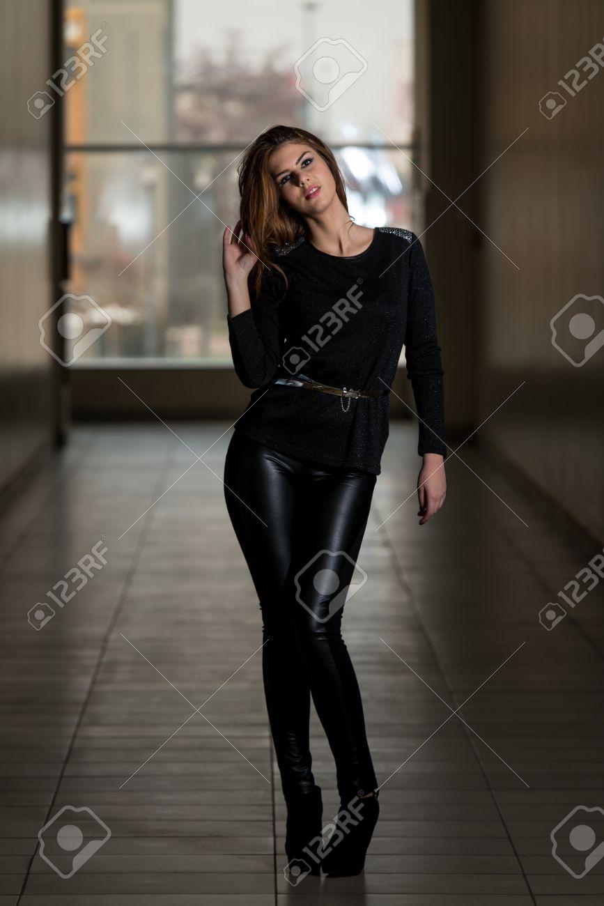 84148b8fdb9 Fashion Girl Wearing Leather Pants And Long Sleeve Stock Photo - 24521690