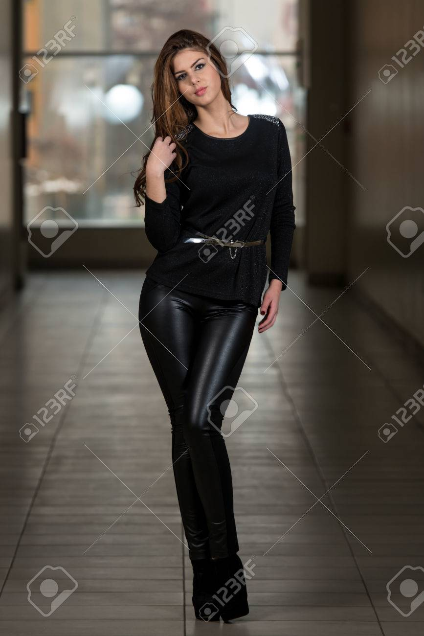 013e441dfd5 Fashion Girl Wearing Leather Pants And Long Sleeve Stock Photo - 24521691
