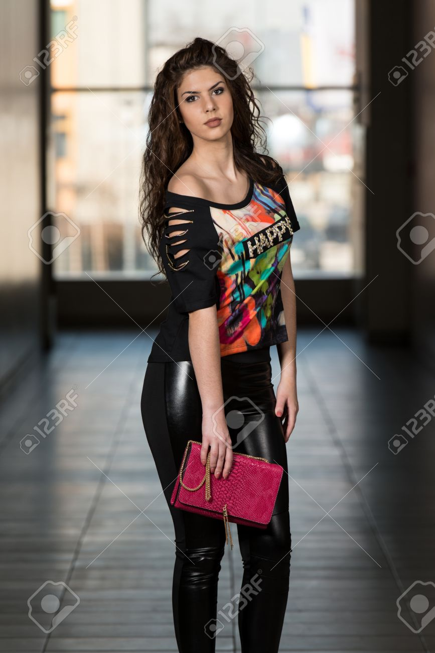 8b63abb7978 Fashion Girl Wearing Leather Pants And Happy T-shirt Stock Photo - 26046291