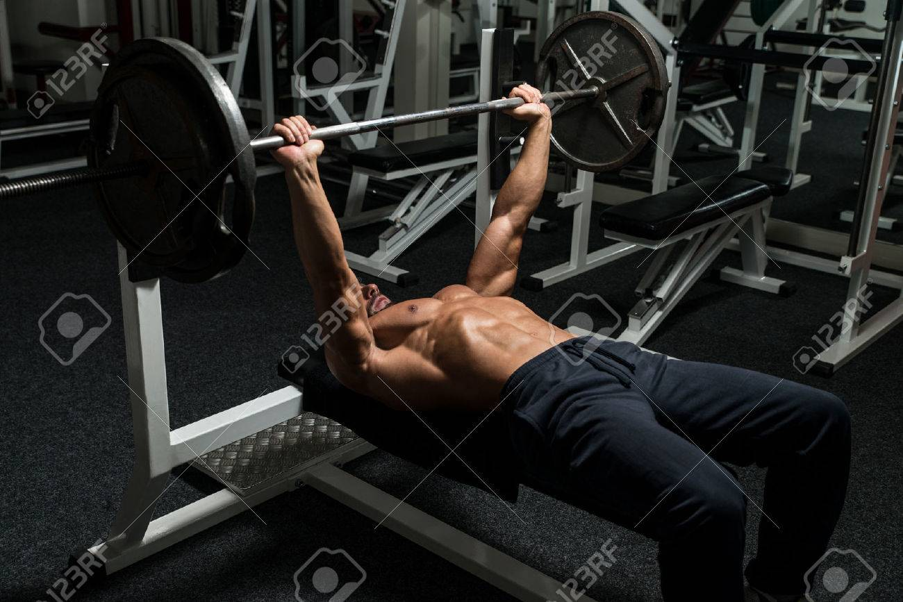 Mature Man In Gym Exercising On The Bench Press Stock Photo - 28405542