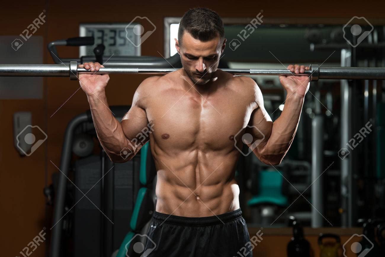 Young Man Performing Barbell Squats - One Of The Best Bodybuilding Exercise For Legs Stock Photo - 28763142
