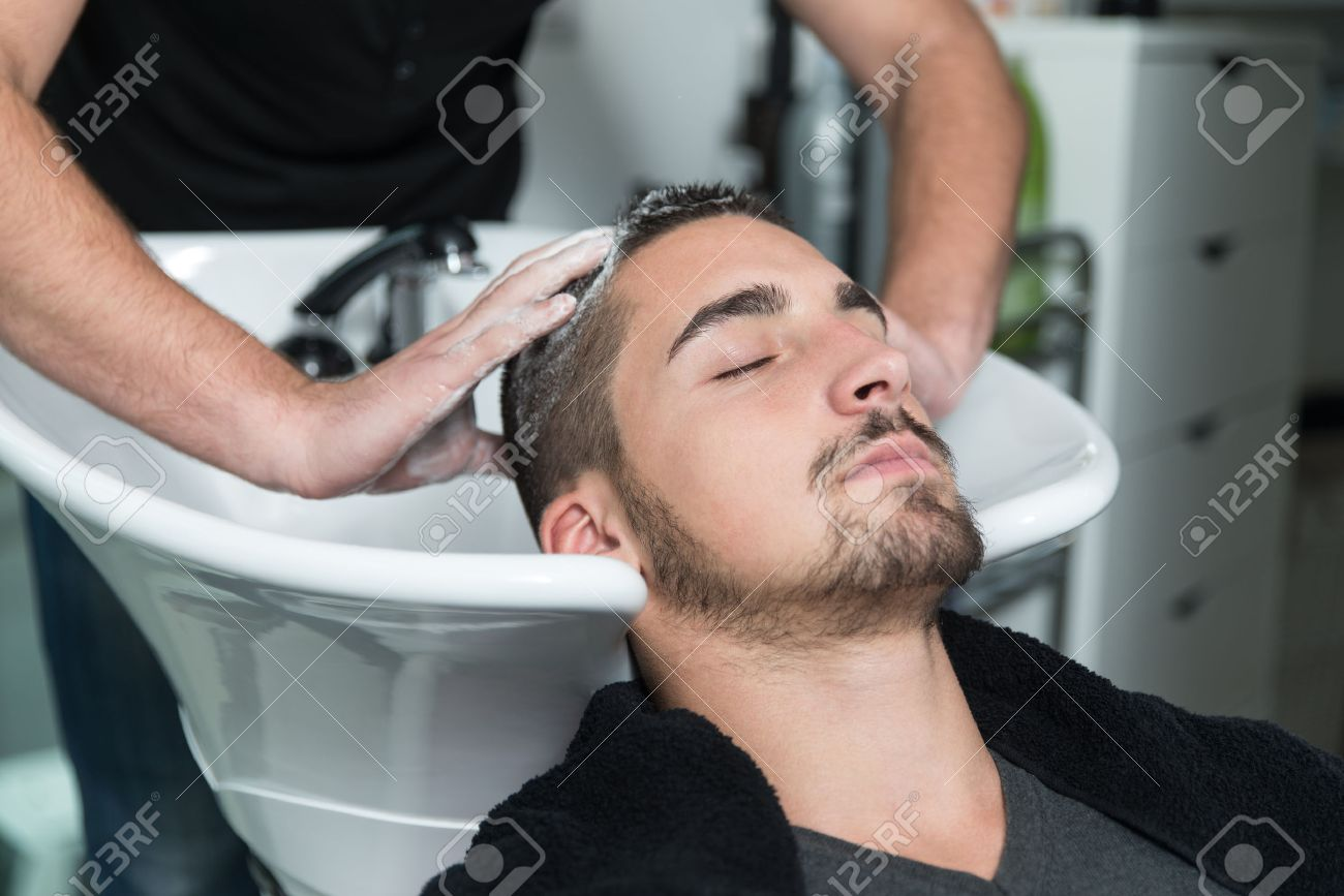 Hairstylist Hairdresser Washing Customer Hair - Young Man Relaxing In Hairdressing Beauty Salon Stock Photo - 34843675