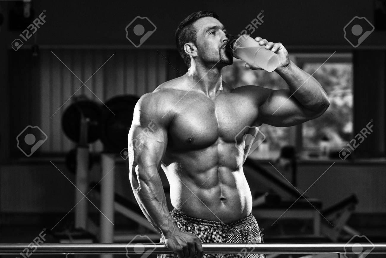 Muscular Man Drinking A Water Bottle Stock Photo - 35998761