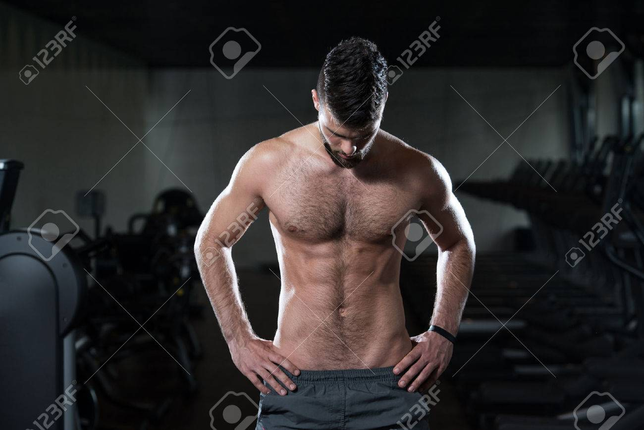 Portrait Of A Young Sporty Man In The Modern Gym With Exercise Equipment Stock Photo - 36522276