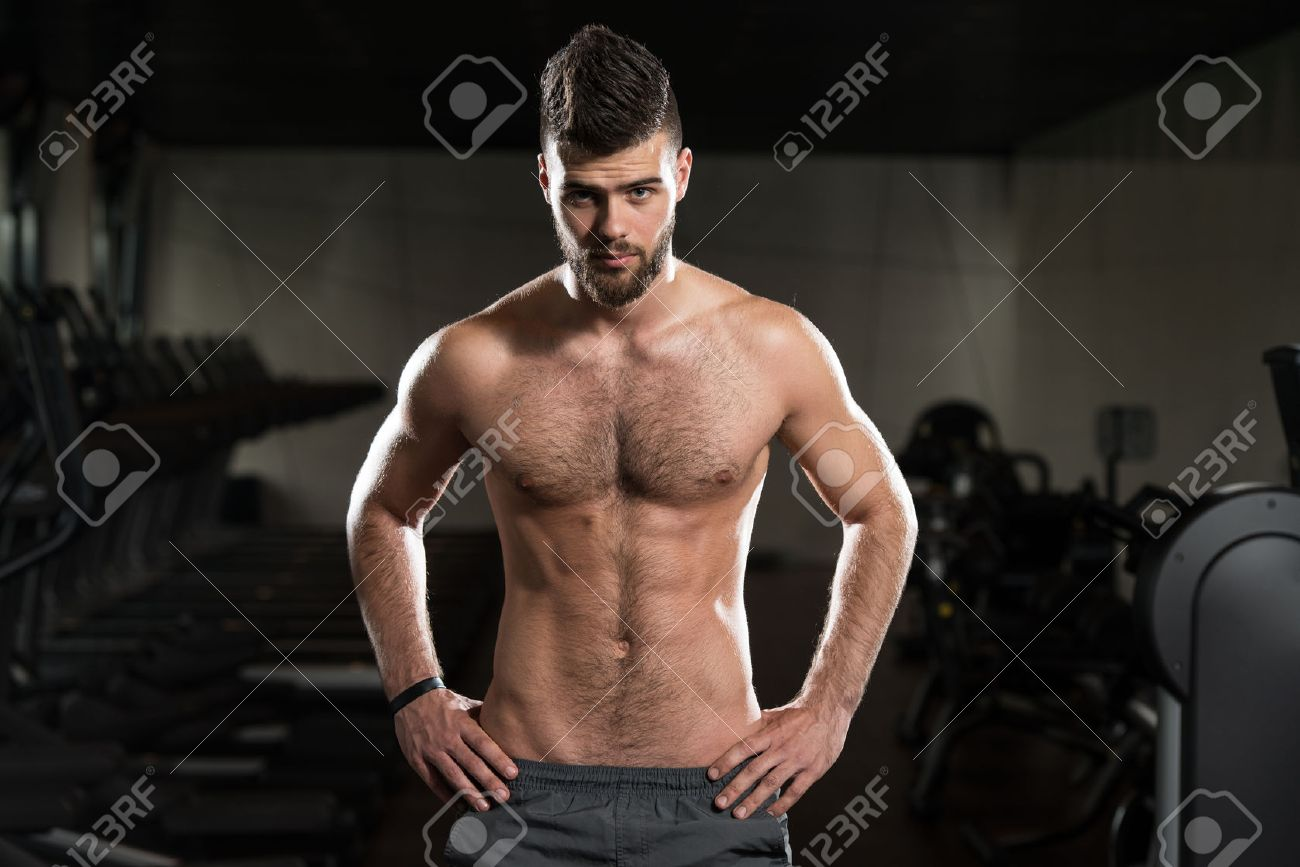 Portrait Of A Young Sporty Man In The Modern Gym With Exercise Equipment Stock Photo - 36522280