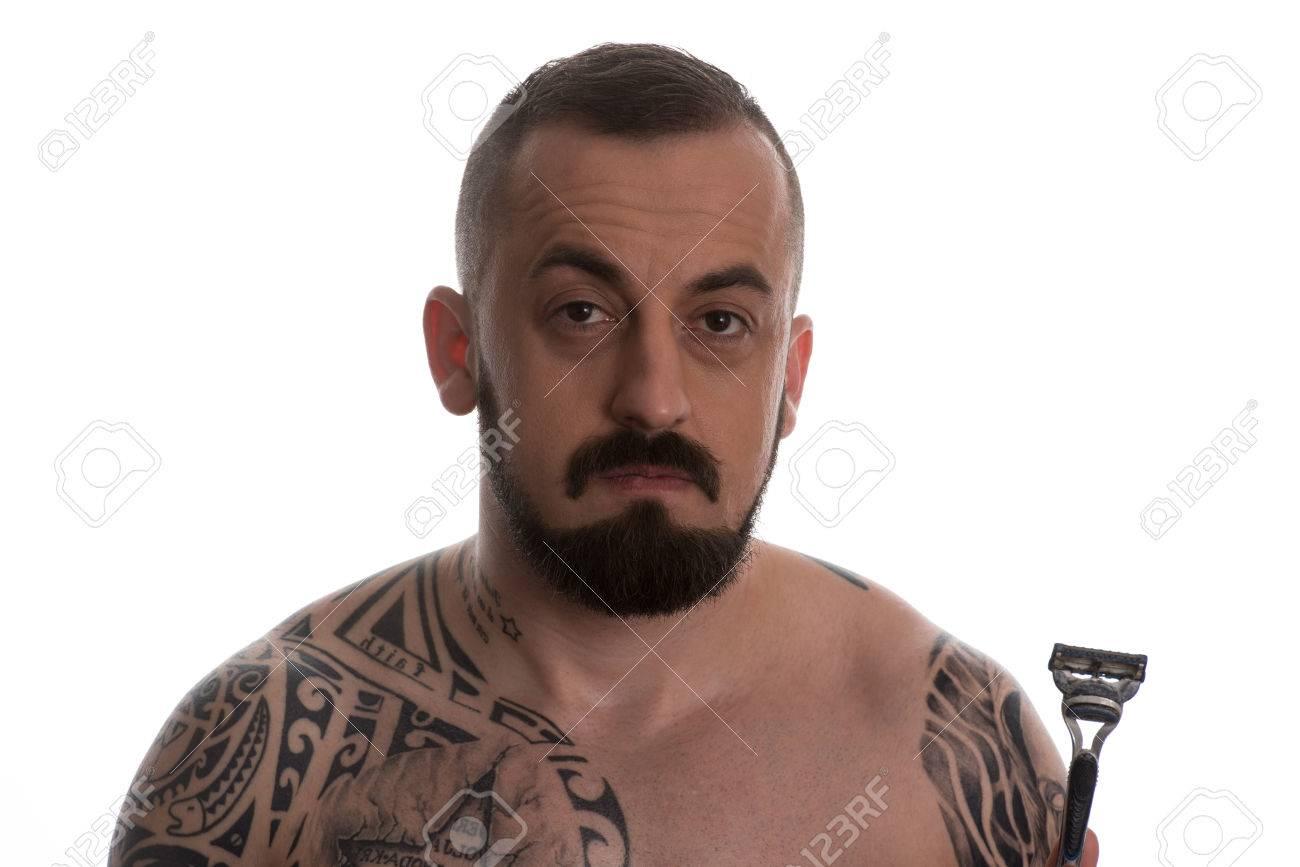Super Tattooed Man Styling Beard Holding Disposable Razor Isolated Short Hairstyles Gunalazisus