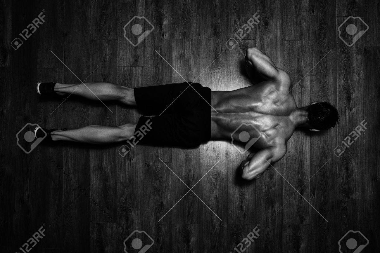 Healthy Athlete Doing Push Ups As Part Of Bodybuilding Training Stock Photo - 46210326