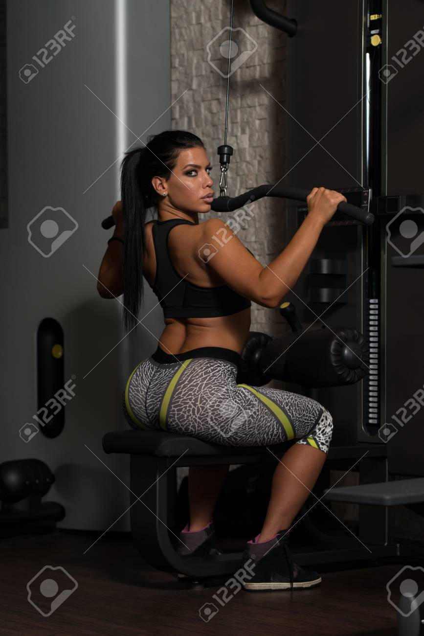 Sexy Latino Woman Working Out Back On Machine In Fitness Center Stock Photo 50219706
